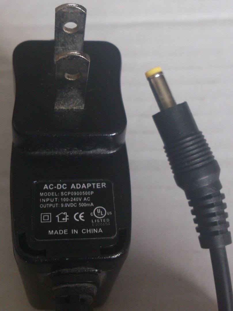 SCP0900500P AC ADAPTER 9VDC 500mA USED -(+)- 1.8x4x9.8mm